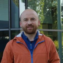 Dr Andrew Caines outside Cambridge Computer Lab