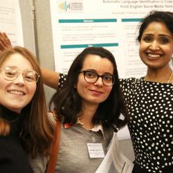 Dr Minha Rajput-Ray with poster presenters Annual Symposium 2019