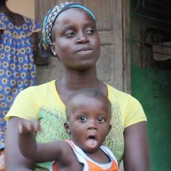 Women with two children being interviewed in Guinea-Bissau for Jacqueline Rowe's fieldwork project